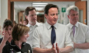 Nick Clegg, David Cameron and Andrew Lansley with staff at Frimley Park Hospital