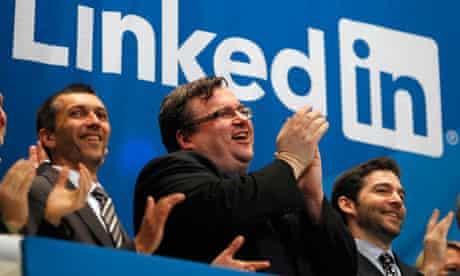 LinkedIn founder Reid Garrett Hoffman (centre) applauds as its shares start trading