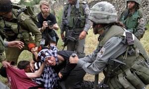 Israeli soldiers disperse Palestinians during a demonstration marking al-Nakba Day in Bethlehem