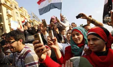 Egyptians use their mobile phone to record celebrations in Cairo's Tahrir Square