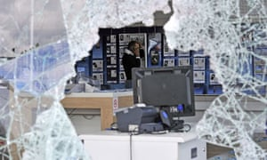 London riots: a looted O2 mobile phone store in Tottenham Hale retail park