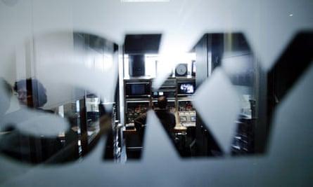 Sky Italia logo on a window, with a studio beyond it