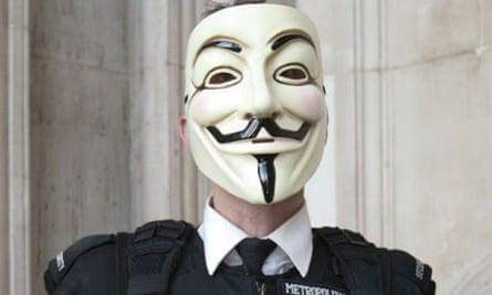 Demonstrator wearing Anonymous V For Vendetta mask at Occupy London
