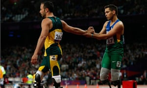 Alan Oliveira congratulated by Oscar Pistorius after winning Men's 200m T44 during Paralympics