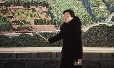 A North Korean guide uses a pointer at the start of a tour of an historic site in Pyongyang