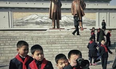North Korean school boys play with David Guttenfelder's camera