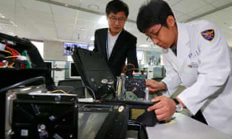Investigators in Seoul check KBS hard drives hit by a hacking attack in March