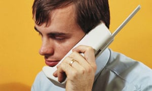 Product designer with a Motorola DynaTAC mobile concept phone in 1972