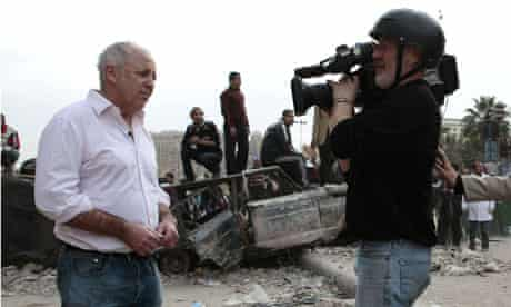 Jeremy Bowen with a BBC TV crew on Tahrir Place in Cairo, Egypt