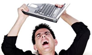 Angry man about to throw his laptop