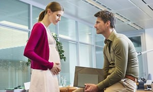 Pregnant woman and man in the office