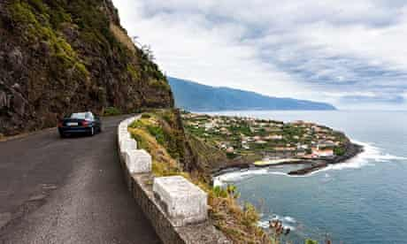 Car driving along coastal cliffs