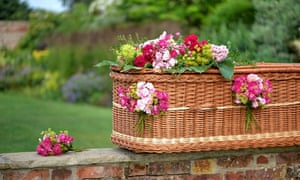 Wicker coffin with flower decoration
