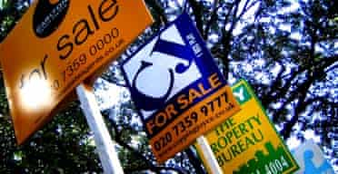 Estate agents signs outside houses for sale