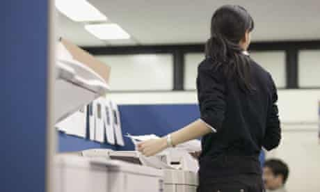 Woman using photocopier in office