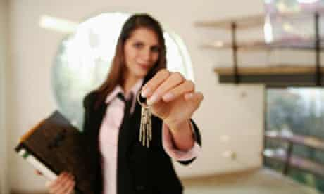 Estate agents with house keys