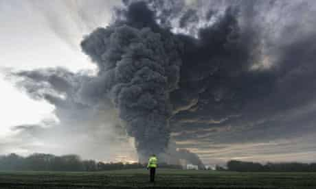 Smoke billows from the Buncefield oil depot