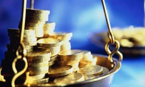 Pound coins in a weighing scale