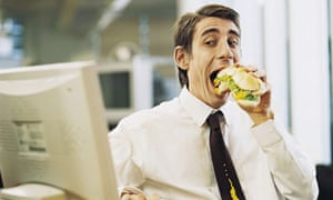 Man eating messily at office desk