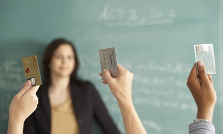 Students holding credit cards
