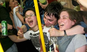 Facebook revellers on the tube. Photograph: Getty