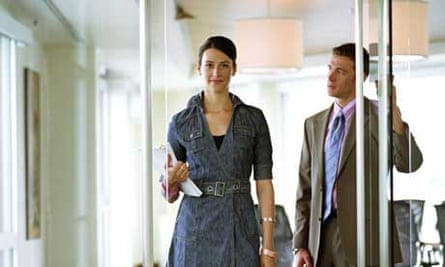A man opens the door for a female colleague