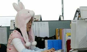 Office worker wearing pyjamas and rabbit hat