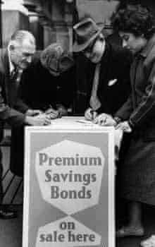 Customers sign up for Premium Savings Bonds in 1956