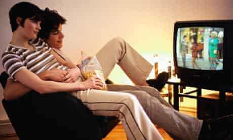 A couple relaxing together watching television