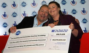 A giant cheque in the hands of lottery winners the Scaddings