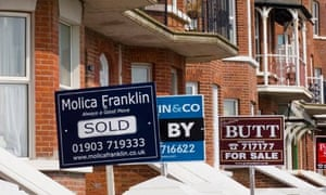 Estate agents for sale signs on beach front properties in Littlehampton, West Sussex