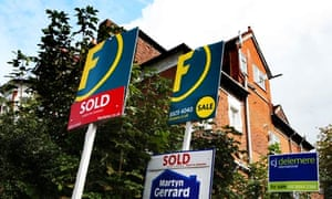 Estate agent signs outside a property in north London.