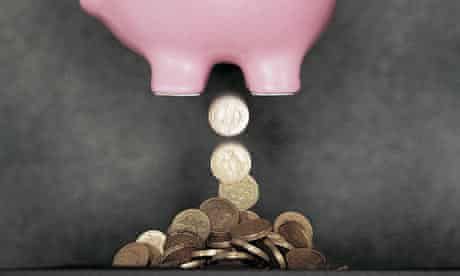 Savings falling out the bottom of a piggy bank