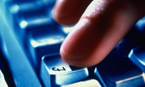 A finger hits the pound sign key of a computer keyboard