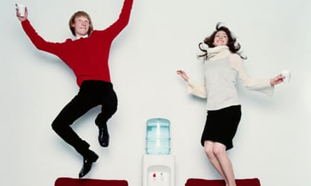 Office workers jumping around after drinking water