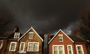 Storm clouds pass over houses in south London