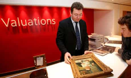 A painting is valued at the new valuation department at Christies Auction House