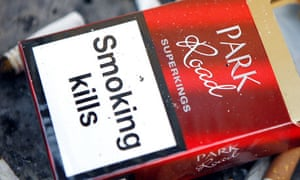 An empty cigarette packet with health warning