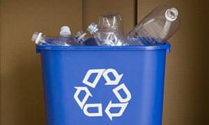 A plastic recycling bin full of bottles