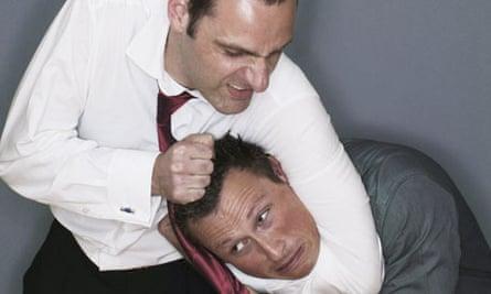 Businessman holding a man in a headlock