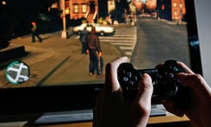A young person plays on a Playstation 3