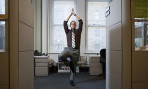 Businessman Doing Yoga in Cubicle