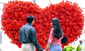 Couple Look At Huge Heart Decoration