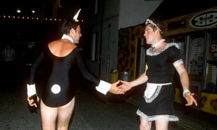 Men on a stag night dressed as a French maid and a bunny
