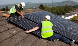 Fitting solar panels to a house roof in Wales