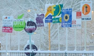 Snow covers property sale signs in west London