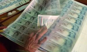 A sheet of freshly printed money
