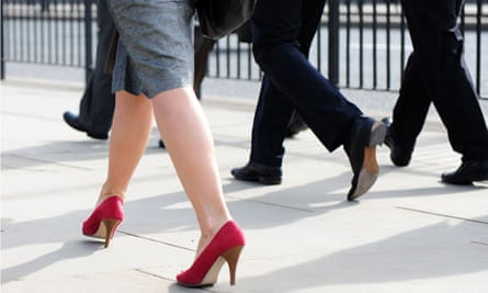 The legs of female and male commuters walking