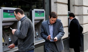 Customers use ATM machines