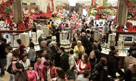 Shoppers crowd the floor at Macy's on a Black Friday.